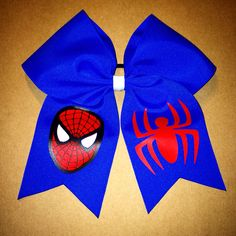 A cheer bow featuring everyone's favorite web slinger - The Amazing Spiderman.   www.facebook.com/MidnightBows  Instagram - @MidnightBows