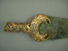 Mycenaean dagger with gold and glass plated handle