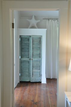 Jane Coslick Cottages  and the closet doors ( old shutters) at Southern Tides at Tybee Island a www.tybeecottages.com vacation rental