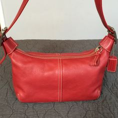 Coach Red Leather Small Bag Beautiful Coach red leather bag with adjustable strap.  This rich brick red leather bag is just stunning and the pictures do not do it justice.  Clean inside and out in like new condition ready for a new home. Coach Bags Satchels