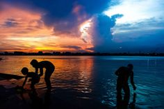 A sunset over Kolkata, India, split the sky in two in this National Geographic Your Shot Photo of the Day.