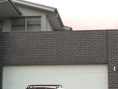Olympus bricks on house