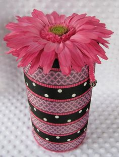 headband holder out of an oatmeal can! And the inside can be used for brushes, hair bows, etc!!