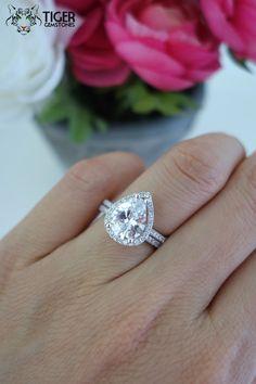 2.5 Carat Pear Cut Halo Engagement Ring, Wedding Set, Man Made Diamond Simulants, Half Eternity Wedding Ring, Sterling Silver, Bridal Set by TigerGemstones on Etsy https://www.etsy.com/listing/236111382/25-carat-pear-cut-halo-engagement-ring
