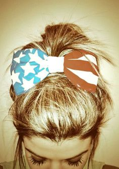 A messy updo with an American flag #hair bow is perfect for warm holidays like 4th of July