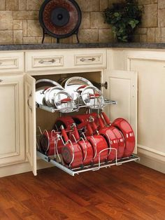 This is how pots and pans should be stored. Lowes and Home Depot sell these..