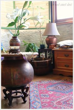 Creatively used - copper pots as an accent table and a lamp