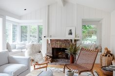 22 Modern Living Room Design Ideas | Sticking to lighter, natural colors like whites, creams, and browns makes it feel like a place you can recharge, says designer Jenni Kayne. Using natural textures in contrast to a bright white also adds an unexpected, yet welcoming look. #realsimple #livingroomdecor #livingroomideas #details #homedecorinspo Living Room Upholstery, Living Room Chairs, Living Room Furniture, Living Room Decor, Cozy Living Rooms, Living Room Modern, Living Room Designs, Barn Living, Art Teen