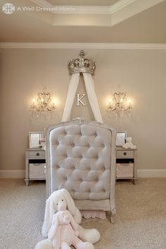 Lucky baby!! I have never seen a tufted crib. This is beautiful. By Emily Hewett & Associates http://awelldressedhome.com/