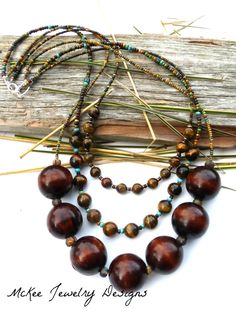 Chunky wood, seed bead, and tigers eye stone chunky necklace. McKee Jewelry Designs