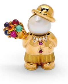 A Gem-Set and Gold Amoureux Brooch, Fred, circa 1990 Of whimsical design, the enamored courting gentleman wearing a bowler hat, with mabe pearl head, diamond-set bow-tie and ruby buttons, shyly holding a cabochon ruby, emerald, and multi-hued sapphire floral bouquet, mounted in polished and matte 18k gold, signed Fred, Paris, French assay marks.