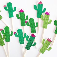 Our sparkling glitter cactus cupcake toppers are a bright and fun addition to any fiesta decorations, Cinco de Mayo party supplies, cactus decor, or summer party decor, and are made from glitter cardstock mounted on bamboo skewers! L I S T I N G + I N C L U D E S =========================== 12 glitter cactus cupcake toppers with flowers, mounted onto wood skewers. → Glitter cupcake toppers are plain white on back. M E A S U R E M E N T S =========================== Each cactus cupcake…