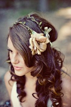 There is such a beautifully enchanted fairy tale princess feel to this fancy (wedding day wonderful) hairstyle. #hair #hairstyle #flowers #wedding Themarriedapp.com hearted <3