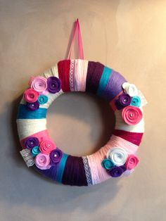 Whool yarn wreath with felt roses and lace wall decoration