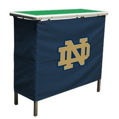 """NCAA Notre Dame Fighting Irish Aluminum High Top Folding Tailgate Table With Carrying Case by Wild Sports. $99.99. Made of light weight, sturdy aluminum.. Folds up into a 40""""x16""""x3"""" nylon carry case!. The ultimate table for tailgating, the high top table is great for outdoors, barbecues, sports and family functions. The surface top and skirt represents a football field which can have you favorite team or school displayed. You simply fold up, grab the handle and go."""