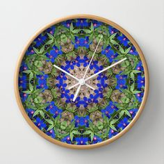 This botanical mandala clock, shows the colors of a peacock in the plant world. The mandala was created from a photograph I took in my garden of