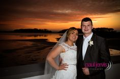 Bride and Groom at Sunset Photo by Paul Jervis Photography, taken at Orange Tree House, Greyabbey, County Down. Northern Ireland wedding photographers.