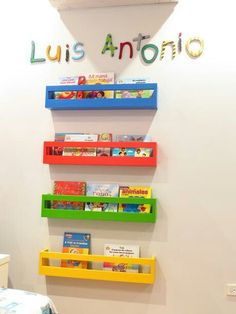 Pallets recycled into brightly colored shelving for a little boys room
