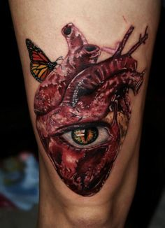 Inspired by Salvador Dali, Carlox Angarita has created a surrealist tattoo of a human heart, eye and butterfly