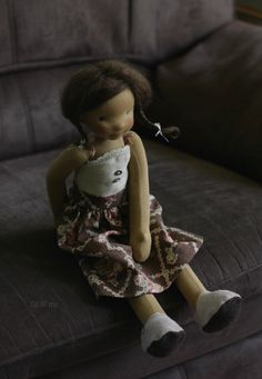 Louella, a natural doll ready for play.