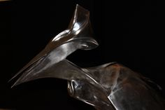 La justice By Jean-michel Diki-Paré original stainless steel sculpture available for purchase on www.passionartly.com By buying this artwork you are doing a good deed, we pledge to donate 5% to the association :French Esophageal Atresia Association (AFAO) - French Charity for Children