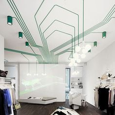 These are photos of MAYGREEN fashion boutique in Hamburg, Germany. We love the patterns created with the exposed electrical work on the ceiling. This is a great option if you've been looking to add more lighting to a room, but aren't so keen on cutting holes in the ceiling and wiring it up!