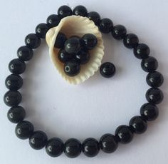 Natural Obsidian Grade AA Round Beads, Stretch Bracelet or as loose Beads 6mm. by SeasideCottageBeads on Etsy https://www.etsy.com/listing/398098743/natural-obsidian-grade-aa-round-beads