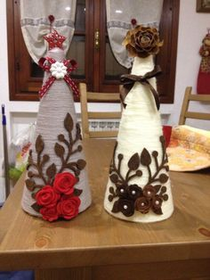 Yarn-wrapped trees, decorated with felt flowers, cut-outs, and ribbon - pic for inspiration