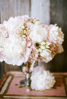 Hydrangea. There's something charming about all the same blooms in a simple container.