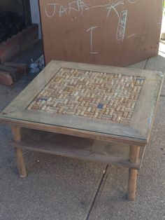 Shabby chic DIY (or with the help of others) coffee table- found end table in garbage- hubby cut legs down to coffee table height- mom sanded off ugly dark color- i stained it- fitted it with corks and had a sheet of glass cut for it...viola!