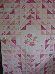 Pretty pink and white quilt.