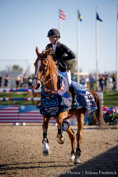 Ashlee Bond Clark & Chela LS win the 2014 AIG Million Grand Prix