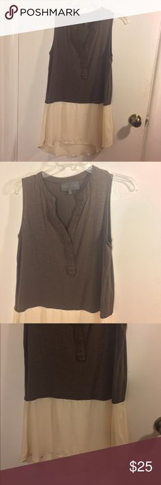 Anthropologie Sundays In Brooklyn Tunic Sundays In Brooklyn brand for Anthropologie size small sleeveless two tone taupe and beige elongated tunic blouse with a v-cut neckline and buttons downtown the center of the upper portions n. No flaws. I have this same blouse in a different color and will be posting it on here soon so let me know if you want both. Anthropologie Tops Blouses