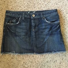 Juicy Couture Denim Mini Juicy Couture semi-distressed denim mini skirt with heart shaped pockets. In great condition.   Size 27, length 11.5in.   98% cotton, 2% spandex. Made in USA. Juicy Couture Skirts Mini