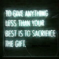 """to give anything less than your best is to sacrifice the gift"" neon sign"