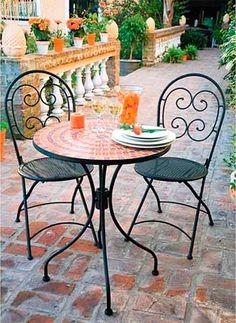 Mueble de jardin en hierro y mosaico