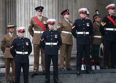 Servicemen stand on the steps of St Paul's Cathedral as family members and senior politici...