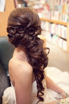 Pin Wheel Curls, Side French Twist Pinned with Long Spiral Curls.