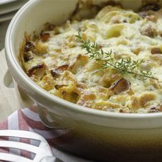 This hearty Potato Bacon Casserole features tender hash browns and succulent bacon pieces. It is a perfect crowd pleaser for brunch or any meal. Bacon Potato Casserole, Easy Casserole Recipes, Potato Dishes, Potato Recipes, Chicken Recipes, Side Dish Recipes, Side Dishes, Recipes Dinner, Main Dishes