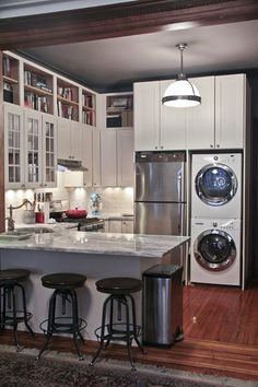 Cabinets to the ceiling, like the vertical lines above fridge; those are my washing machine and dryer!; black ceiling
