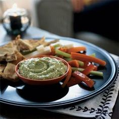 Scoop this creamy dip with pita chips and carrot, celery, red bell pepper, and jicama sticks. Prepare up to eight hours in advance, and refrigerate in an airtight container. To further simplify your evening, use precut vegetables from the produce section.