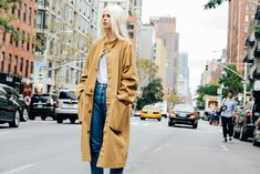 Shop this look for $54:  http://lookastic.com/women/looks/tan-trenchcoat-and-white-crew-neck-t-shirt-and-blue-jeans/3677  — Tan Trenchcoat  — White Crew-neck T-shirt  — Blue Jeans
