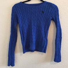 Blue Abercrombie kids sweater! This sweater runs small but it's a size large. Stretchy material! Very cute and comfortable! Some fuzz balls on it but otherwise great condition. Abercrombie & Fitch Tops Sweatshirts & Hoodies