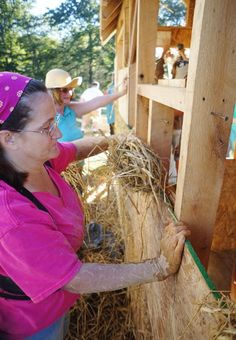 Stuffing light clay straw into the wall cavity