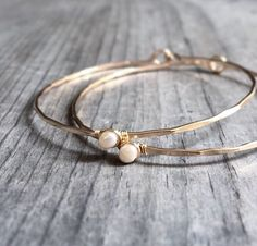 A personal favorite from my Etsy shop https://www.etsy.com/listing/209557480/freshwater-pearl-bangle-14k-gold-filled