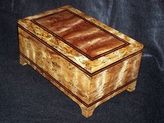 Exotic wood hardwood box with beautifully hand created out of wood from Cook Woods. www.cookwoods.com