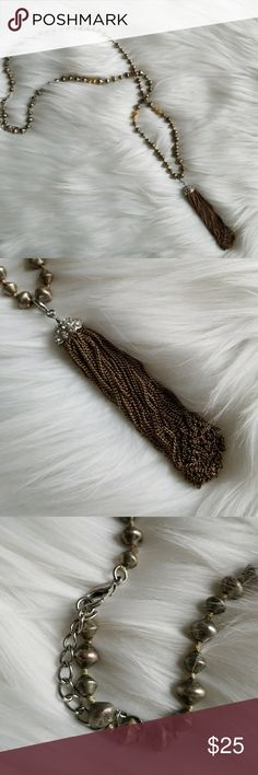 Tassel Statement Necklace Gold and silver come together to make a stunning timeless statement necklace featuring tassels and unique beading. Jewelry Necklaces