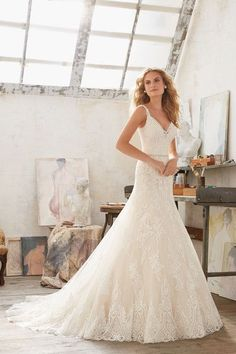 A vintage-style wedding dress by Morilee by Madeline Gardner with a figure-flattering fit and flair silhouette. Style 8122 by @morileewedding