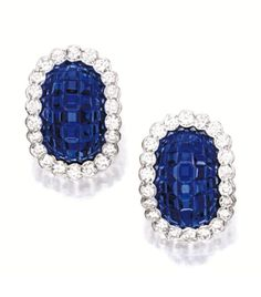 PAIR OF SAPPHIRE AND DIAMOND EAR CLIPS, VAN CLEEF & ARPELS.  Each of bombé form, mystery-set with calibré-cut sapphires, surrounded by brilliant-cut diamonds altogether weighing approximately 2.50 carats, mounted in platinum, signed and numbered 31383.
