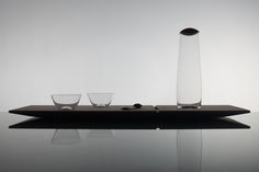 "The tray with glass set ""Truffle"" is inspired by Japanese aesthetic and also by opened bonbonniere where are some of chocolates already missing. So one is able to move with chocolates as he wishes. The same idea is attached to the tray. It contains a glass set for two people. But there are three spots on wich you can place cups. So you can move wooden truffles and glass cups in order to achieve your own combination."